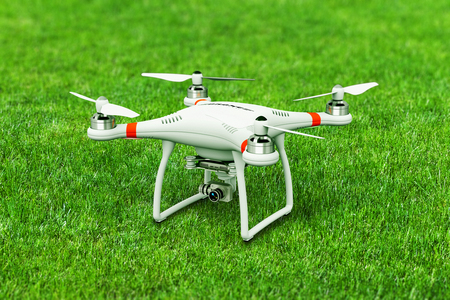 Creative abstract 3D render illustration of professional remote controlled wireless RC quadcopter drone with 4K video and photo camera for aerial photography on green grass field with selective focus effect Stock Photo