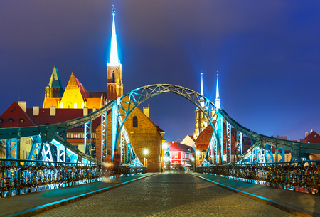 Scenic summer night view of the Old Town illuminated pier architecture and bridge in Wroclaw, Poland Stock Photo