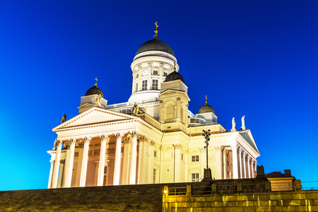 Famous landmark in Finnish capital: scenic night summer view of the Lutheran Cathedral Church at the Senate Square in Helsinki, Finland