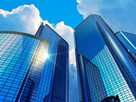 Downtown corporate business district architecture concept: glass reflective office buildings skyscrapers against blue sky with clouds and sun light Banco de Imagens