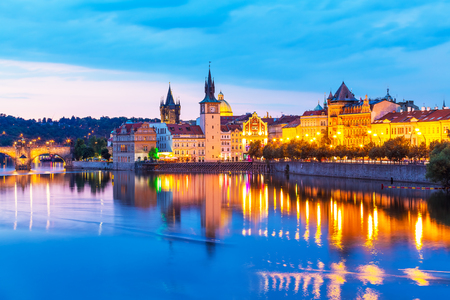 Scenic summer sunset panorama of the Old Town ancient architecture and Vltava river pier in Prague, Czech Republic