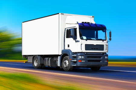Creative abstract shipping industry, logistics transportation and cargo freight transport industrial business commercial concept: white delivery truck or container auto car trailer on road, way or highway with high speed motion blur effect