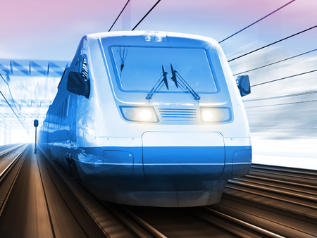railway transportation: Creative abstract railroad travel and railway tourism transportation industrial concept: scenic winter view of modern high speed passenger commuter train on tracks with snow and mountains with motion blur effect Stock Photo