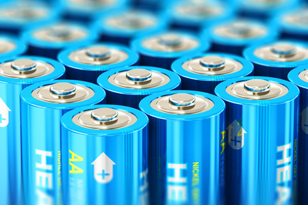Creative abstract 3D render illustration of the macro view of group of blue AA size 1.5 volts alkaline cell batteries or rechargeable accumulators with selective focus effect Stock Photo