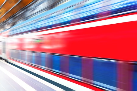railway transportation: Creative abstract railroad travel and railway transportation industrial concept: modern red high speed electric passenger commuter double deck train at station platform with motion blur effect