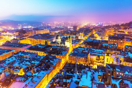 Scenic winter night snowy aerial view of the Old Town architecture in Lviv, Ukraine Stock Photo