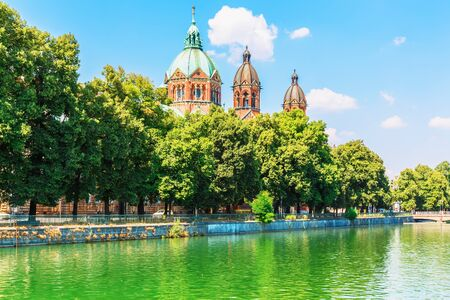 europe: Scenic summer view of Isar river embankment architecture in the Old Town of Munich, Bavaria, Germany Stock Photo
