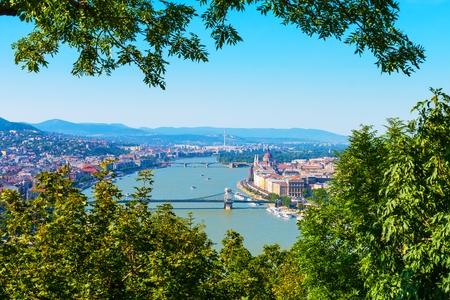 Scenic summer aerial panoramic view of the Old Town pier architecture, Danube river, bridges and famous gothic Parliament building in the Old Town of Budapest, Hungary