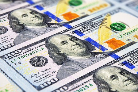 new: Creative abstract business, financial success and making money concept: macro view of group of new 100 US dollar 2013 edition banknotes or bills with selective focus effect
