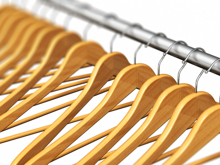 3D render illustration of the row of wooden coat hangers on metal shiny clothes rail isolated on white background with selective focus effect