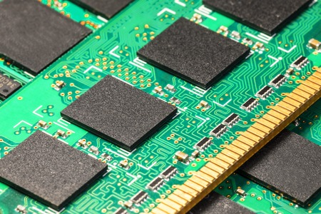 Creative abstract electronic industry business technology concept: macro view of the group of computer PC DRAM memory modules circuit board PCB with selective focus effect