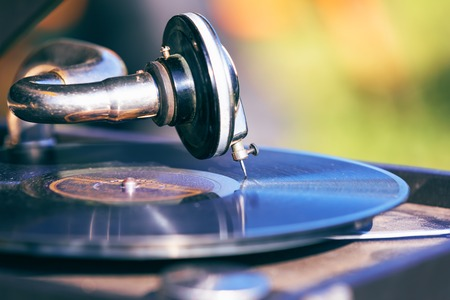 Macro view of the old style retro vintage music record player turntable with vinyl disc