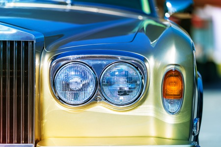 Close view of the front fragment of the old style retro vintage car auto Stock Photo