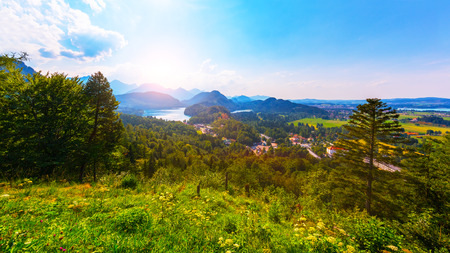 Scenic summer view of sunset at the Alpsee lake, Ostallgau District, Bavaria, Germany Stock Photo