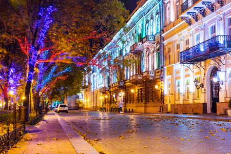 Scenic autumn night view of the Old Town illuminated architecture with a lot of color street lights at Primorsky Boulevard, Odessa, Ukraine 免版税图像