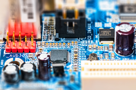 Creative abstract electronic industry business technology concept: macro view of computer PC motherboard or mainboard circuit board PCB with selective focus effect 스톡 콘텐츠