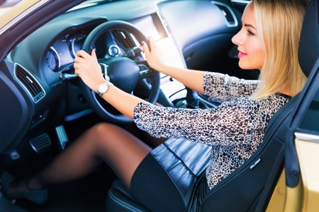 Happy smiling young woman in the modern luxury car Stock Photo