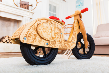 Close view of the wooden runbike in the living room at home interior