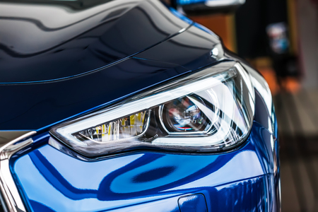 Macro view of modern blue car headlight