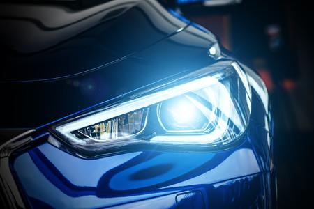 Makro widok reflektorów nowoczesnych niebieski samochód ksenonowe lampy Zdjęcie Seryjne