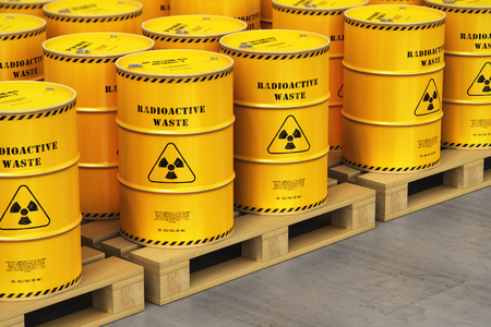 Creative abstract nuclear power fuel manufacturing, disposal and utilization industry concept: 3D render illustration of the group of yellow metal barrels, drums or containers with poison dangerous hazardous radioactive materials on wooden shipping pallets in the industrial storage warehouse with selective focus effect Standard-Bild