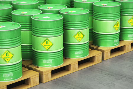 Creative abstract ecology, alternative sustainable energy and environment protection saving business concept: 3D render illustration of the group of green stacked metal biofuel drums or biodiesel barrels in the industrial storage warehouse with selective focus effect