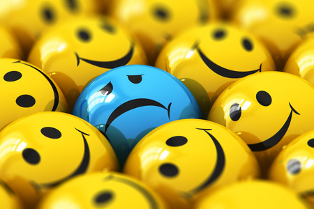 Creative abstract 3D render illustration of the macro view of single dull and sad blue smiley among happy yellow ones with selective focus effect Stock Photo