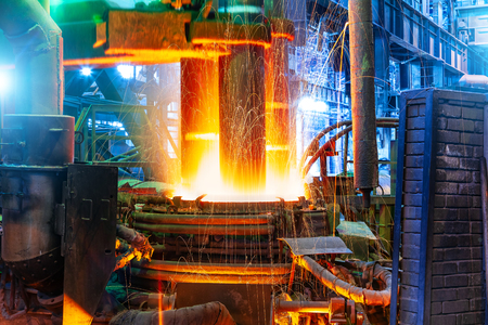Working electroarc furnace at the metallurgical plant workshop Stock Photo