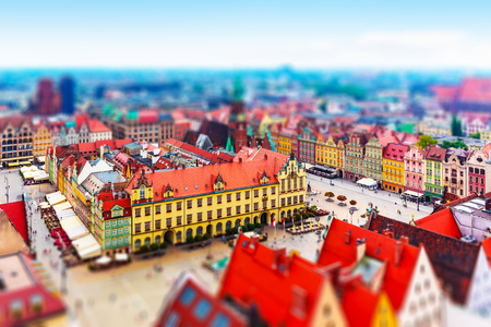 Scenic summer aerial panorama of the Old Town architecture and Market Square in Wroclaw, Poland with tilt shift selective focus effect