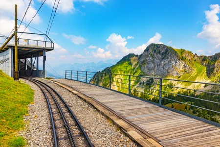 Scenic summer view of the cogwheel railway station on the way to Rochers de Naye mountain peak in Switzerland