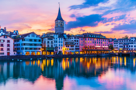 Scenic summer sunset view of the Old Town pier architecture and Limmat river embankment in Zurich, Swizerland
