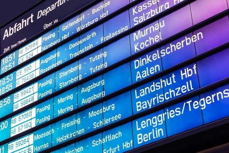 Creative abstract business travel and railway transportation concept: railroad departure and arrival board with train timetable in Germany Stockfoto