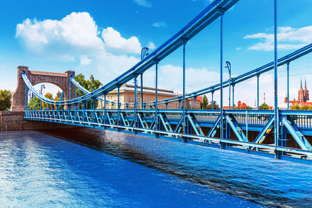 Scenic summer view of Grunwald Bridge over Oder river in the Old Town of Wroclaw, Poland 스톡 콘텐츠