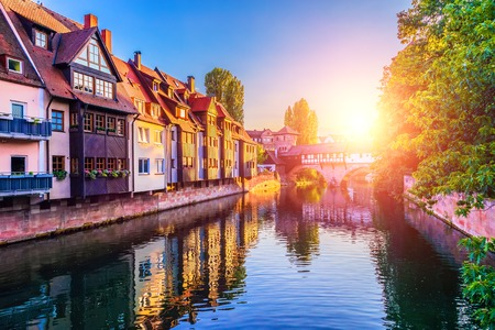 Scenic summer sunset view of the bridge over Pegnitz River in the Old Town architecture of Nurnberg, Bavaria, Germany