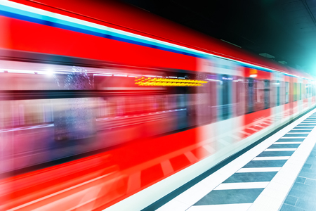Creative abstract commuter city business travel transportation concept: subway underground metro train at railway station platform with high speed motion blur effect Stockfoto