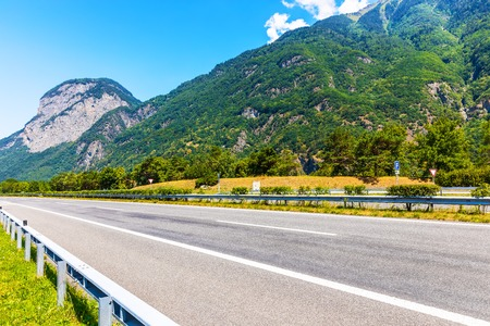 Scenic summer view of the empty autobahn in Alps Mountains, Switzerland 스톡 콘텐츠