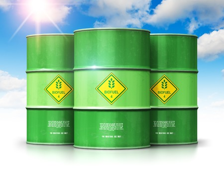 Creative abstract ecology, alternative sustainable energy and environment protection saving business concept: 3D render illustration of the group of green metal biofuel drums or biodiesel barrels against blue sky with clouds and sun light isolated on white background with reflection effect Stockfoto