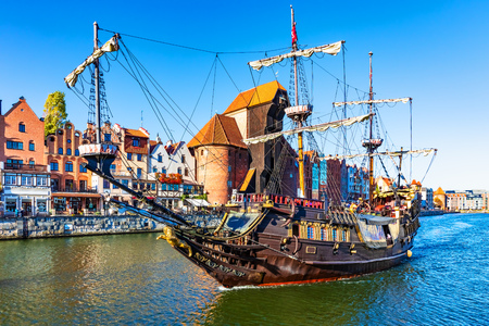 Scenic view of ancient historical tall ship sainig by the Motlawa River in the Old Town of Gdansk, Poland