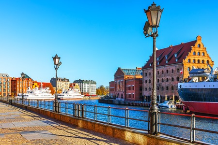 Scenic view of the Old Town pier architecture of Gdansk, Poland at the Motlawa River harbor embankment with medieval port and historical ships Stockfoto