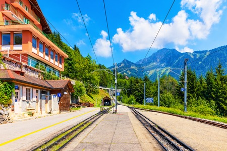 Scenic summer view of Caux cogwheel railway station on the way up to the Rochers de Naye mountain peak in Alps Mountains, Switzerland
