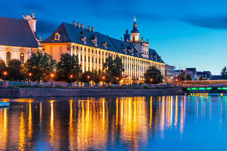 Scenic summer night view of the University building and Oder river embankment in the Old Town of Wroclaw, Poland
