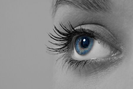 shinning light: Beautiful blue eye Stock Photo