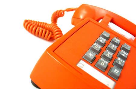 Old-school orange telephone, focus on buttons.