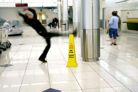 Man slips next to Wet Floor sign Reklamní fotografie - 503106