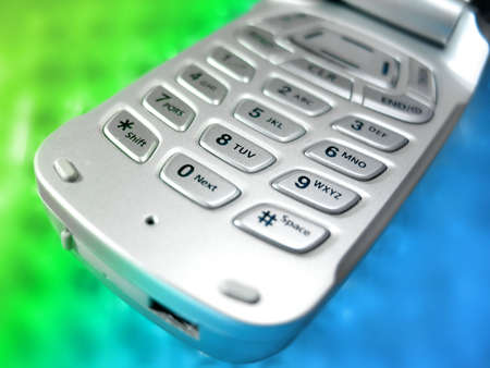 Closeup of cellphone buttons on a blurred blue and green background Zdjęcie Seryjne