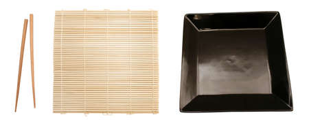 Isolated bamboo mat, dish and chopsticks