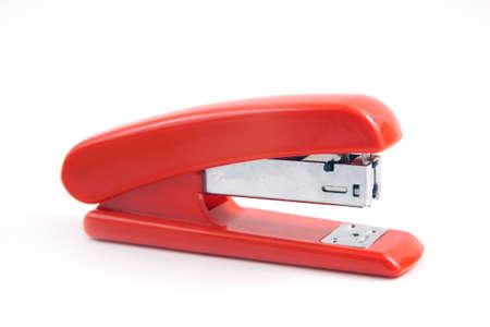 office stapler: Red stapler isolated on white
