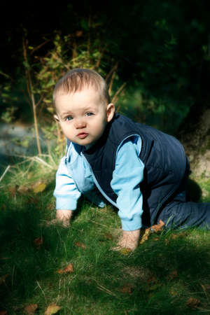 Adorable little boy playing in a park Stock Photo