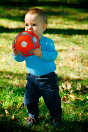 darling: Adorable little boy playing in a park Stock Photo