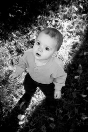 Adorable little boy playing in a park - Black and White version photo